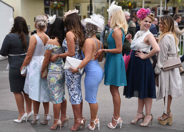 Racegoers enjoy the atmosphere of ladies Day, the second day of the Aintree Grand National Festival meeting, on April 8, 2016 in Aintree, England. (Photo by Oli Scarff/AFP Photo)