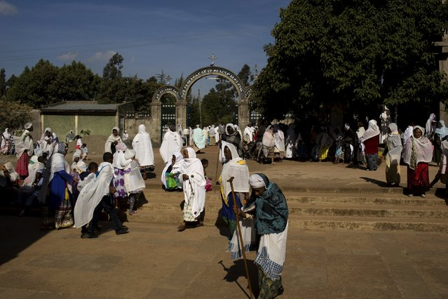 Christian Orthodox faithful pray and walk outside a church during Sunday morning mass in Addis Ababa, Ethiopia, May 17, 2015. (Photo by Siegfried Modola/Reuters)
