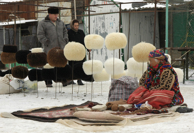 Turkmen vendor sells home made traditional Turkmen hats at an open market in Kara Kum desert 15 km (9,3 miles) outside the county's capital Ashgabat, February 2, 2006. Most of the hats are created according to ancient technology and traditional design. (Photo by John Russel/Reuters)