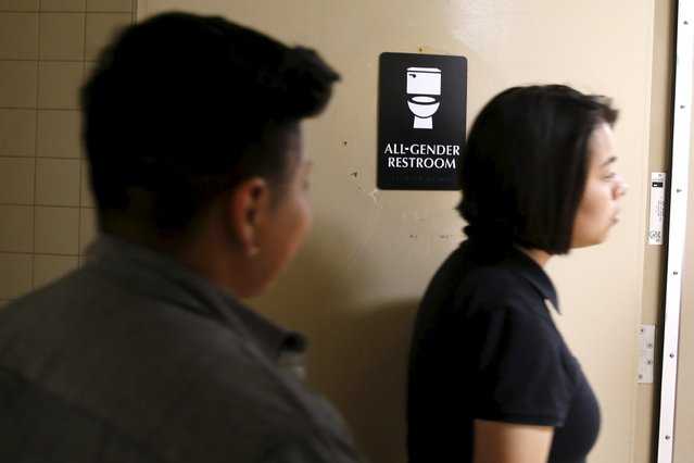 Alonzo Hernandez, 16, and Juliet Dominguez, 15, walk out of the first gender-neutral restroom in the Los Angeles school district at Santee Education Complex high school in Los Angeles, California, U.S., April 18, 2016. (Photo by Lucy Nicholson/Reuters)
