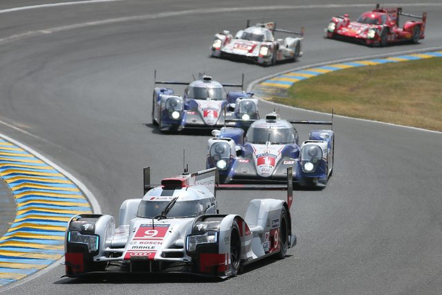 The Audi R18 E-TRON Quattro No9 of the Audi Sport Team Joest driven by Filipe Albuquerque of Portugal, Marco Bonanomi of Italy and Rene Rast of Germany is seen in action during the 83rd 24-hour Le Mans endurance race, in Le Mans, western France, Saturday, June 13, 2015. (AP Photo/David Vincent)