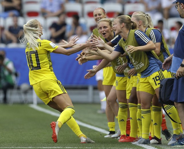 Sweden's Sofia Jakobsson, left, celebrates after scoring her side's second goal during the Women's World Cup third place soccer match between England and Sweden at Stade de Nice, in Nice, France, Saturday, July 6, 2019. (Photo by Claude Paris/AP Photo)