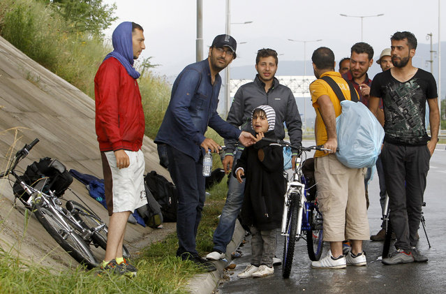 A group of migrants from Syria and Iraq rest to shelter from the rain in an underpass near Petrovec, some 20 kms (12 miles) east of Skopje, Macedonia, Wednesday, June 17, 2015. Macedonia has become one of the main transit routes for thousands of migrants from the Middle East and Africa who enter the European Union in Greece from Turkey and then make their way overland on foot or bicycle to the more prosperous northern countries. (AP Photo/Boris Grdanoski)