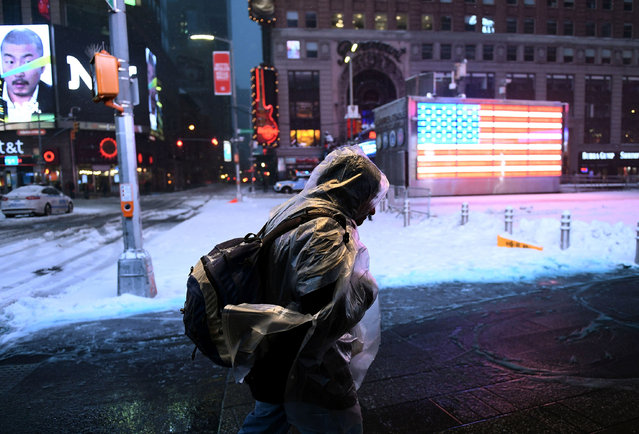 A man makes his way at the Times Square during a snowstorm in New York on March 14, 2017. Winter Storm Stella unleashed its fury on much of the northeastern United States on Tuesday, dropping snow and sleet across the region and leading to school closures and thousands of flight cancellations.Stella, the most powerful winter storm of the season, was forecast to dump up to two feet (60 centimeters) of snow in New York and whip the area with combined with winds of up to 60 miles per hour (95 kilometers per hour), causing treacherous whiteout conditions. (Photo by Jewel Samad/AFP Photo)