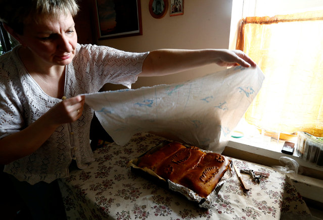 A woman bakes traditional cakes on the eve of Orthodox Easter in the town of Bobruisk, Belarus, April 30, 2016. (Photo by Vasily Fedosenko/Reuters)