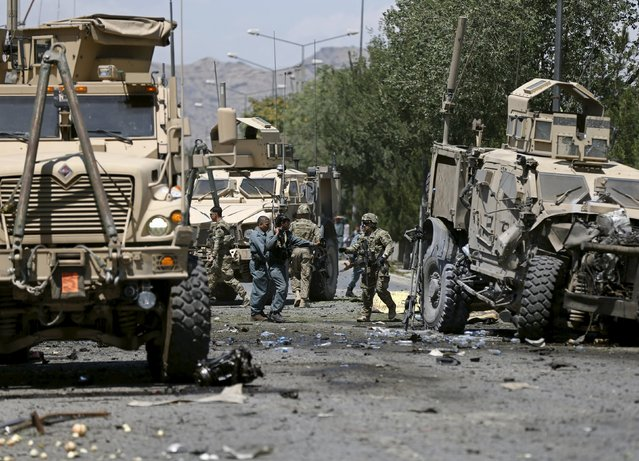 U.S. soldiers inspect the site of a suicide attack in Kabul, Afghanistan June 30, 2015. (Photo by Mohammad Ismail/Reuters)