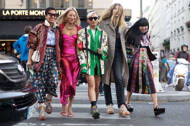 Guests are seen on the street during Paris Fashion Week SS19 wearing Gucci on September 24, 2018 in Paris, France. (Photo by Matthew Sperzel/Getty Images)