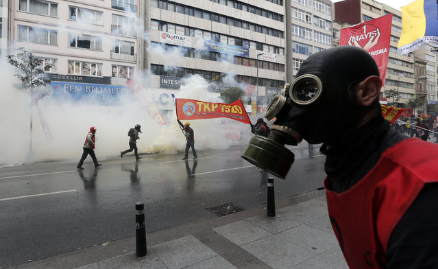 Turkish protestors clash with riot police as police use water cannon and tear gas to disperse protestors during a rally for May day in Istanbul, Turkey, May 1, 2014. Police in Istanbul were on May 1 using water cannon and firing tear gas at protesters attempting to reach the city's Taksim Square, local media reported, where the May Day rallies have been banned. (Photo by Sedat Suna/EPA)