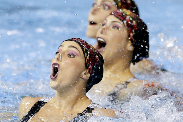 Members of Brazil's synchronized swimming team perform during technical routine competition for the Pan Am Games in Toronto, Thursday, July 9, 2015. (Photo by Gregory Bull/AP Photo)