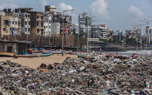 Indian people look for reusable things amidst left over eatables and plastic waste, near the Arabian Sea coast at Versova beach in Mumbai, India, 27 September 2019. Millions of people across the world are taking part in demonstrations demanding action on climate issues. The Global Climate Strike Week is held from 20 September to 27 September 2019. (Photo by Divyakant Solanki/EPA/EFE/Rex Features/Shutterstock)