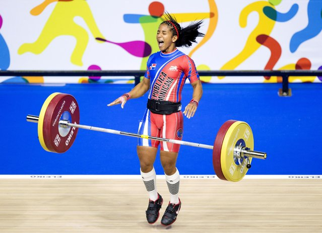 Candida Vasquez Hernandez of the Dominican Republic celebrates after winning the gold medal in women's 48kg weightlifting at the 2015 Pan Am Games in Toronto, Saturday, July 11, 2015. (Photo by Darren Calabrese/Canadian Press via AP Photo)