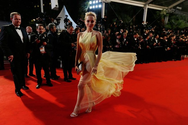 """Canadian actress Sarah Gadon smiles as she arrives for the screening of the film """"Maps to the Stars"""" at the 67th edition of the Cannes Film Festival. (Photo by Valery Hache/AFP Photo)"""