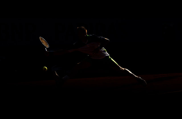 Tommy Robredo of Spain returns a shot during his men's singles tennis match against John Isner of the United States on day six of the French Open at Roland Garros in Paris, France, on May 30, 2014. (Matthias Hangst/Getty Images)