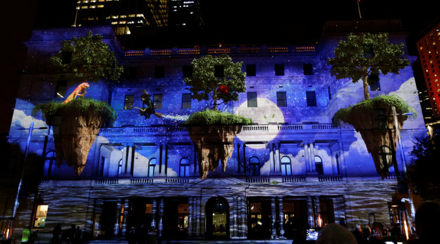 An animated film featuring a lizard and a witch on floating islands is projected onto Sydney's Customs House during the opening night of the annual Vivid Sydney light festival in Sydney, Australia May 27, 2016. (Photo by Jason Reed/Reuters)
