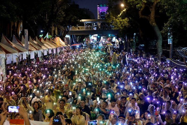 Supporters wave their mobile phone torches in the colors of the rainbow during a rally after Taiwan's constitutional court ruled that same-s*x couples have the right to legally marry, the first such ruling in Asia, in Taipei, Taiwan May 24, 2017. (Photo by Tyrone Siu/Reuters)