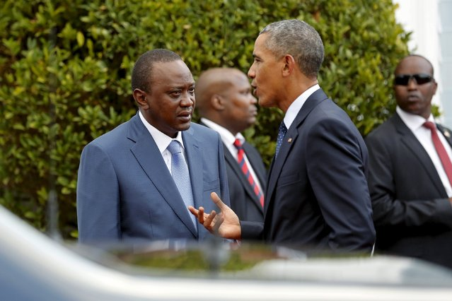 Kenya's President Uhuru Kenyatta (L) listens to U.S. President Barack Obama after their joint news conference at the State House in Nairobi July 25, 2015. (Photo by Jonathan Ernst/Reuters)
