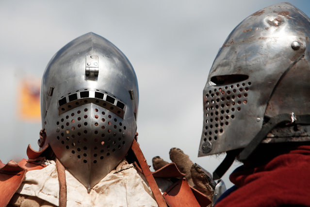 Men wearing armor attend a reenactment of the Battle of Agincourt, in Agincourt, northern France, Saturday, July 25, 2015. (Photo by Thibault Camus/AP Photo)