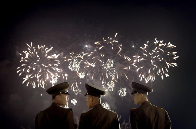 North Korean soldiers watch as fireworks explode, Monday, July 27, 2015, in Pyongyang, North Korea as part of celebrations for the 62nd anniversary of the armistice that ended the Korean War. (Photo by Wong Maye-E/AP Photo)
