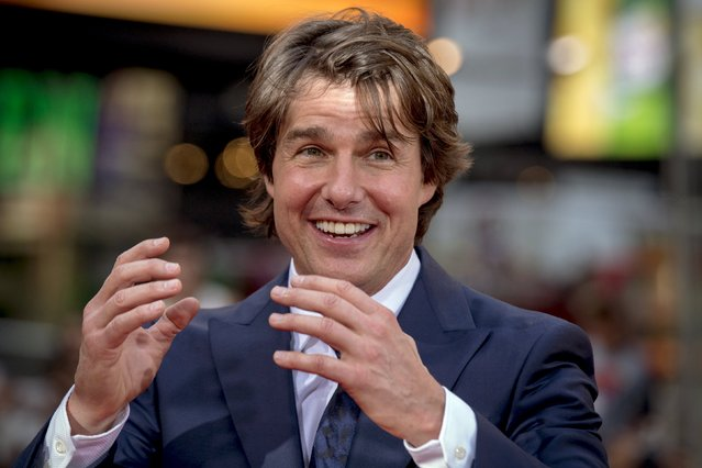 """Actor Tom Cruise poses on the red carpet for a screening of the film """"Mission Impossible: Rogue Nation"""" in New York July 27, 2015. (Photo by Brendan McDermid/Reuters)"""