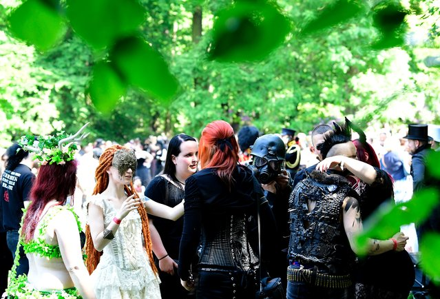 "Dressed up people attend a so-called ""Victorian Picnic"" during the Wave-Gotik-Treffen (WGT) festival in Leipzig, eastern Germany, on June 2, 2017. (Photo by Tobias Schwarz/AFP Photo)"