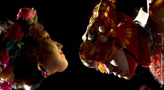 A performer with Flam Chen Pyrotechnic Theatre faces off with a procession participant prior to the grande finale of the Tucson All Souls Procession, Nov. 9, 2008 in Tucson, Ariz