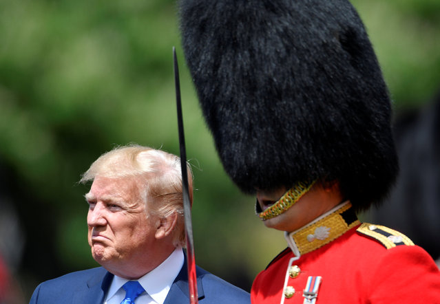 U.S. President Donald Trump inspects an honour guard at Buckingham Palace, in London, Britain, June 3, 2019. (Photo by Toby Melville/Reuters/Pool)