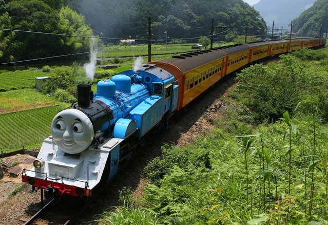 This picture taken on July 2, 2014 shows a life-sized Thomas the Tank Engine making a test run in the mountains on a line run by Japan's Oigawa railway near the city of Shimada in Shizuoka prefecture, west of Tokyo. (Photo by AFP Photo/JIJI Press)