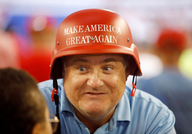 """A supporter of U.S. President Donald Trump wears a helmet emblazoned with the """"Make America Great Again"""" slogan, at a """"Keep America Great"""" campaign rally in Greenville, North Carolina, U.S., July 17, 2019. (Photo by Jonathan Drake/Reuters)"""