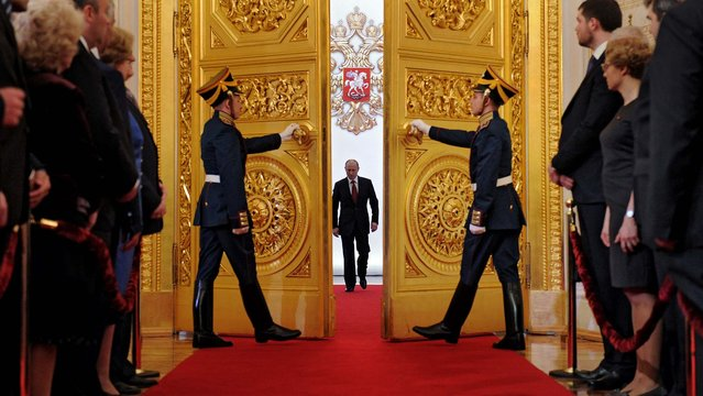 Vladimir Putin enters St. Andrew's Hall to take the oath of office during his inauguration as new Russia's president, in the Grand Kremlin Palace in Moscow. Putin was sworn in as Russia's president for a third term after four years as prime minister