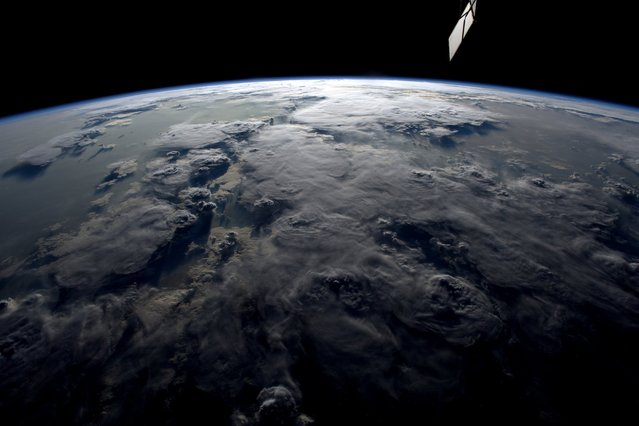 "European Space Agency astronaut Tim Peake will return home after a six-month long mission on the International Space Station,on June 18, 2016. Peake was the first British ESA astronaut to visit the ISS and captured hundreds of photographs of the Earth during his mission. Here: ""Lots of sun-glint right now during our whole orbit – we haven't seen a sunset for over 3 days"", he wrote. (Photo by Tim Peake/ESA/NASA)"