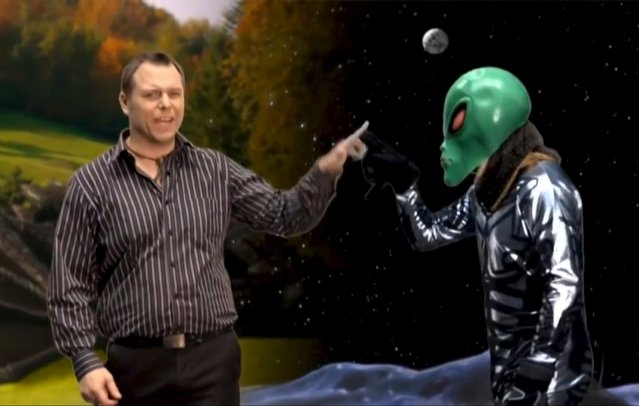 Canadian independent parliamentary candidate Wyatt Scott appears with an alien in a still image from a promotional video provided by his campaign office. He rides a Canada goose, slays a dragon and fist bumps an alien – and that's just in the first 30 seconds of Wyatt Scott's campaign video for the upcoming Canadian federal election. (Photo by Wyatt Scott/Reuters)
