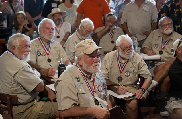 """Past winners of the """"Papa"""" Hemingway Look-Alike Contest judge 2014 contestants at Sloppy Joe's Bar in Key West, Florida in this handout photo provided by the Florida Keys News Bureau July 17, 2014. About 130 men are entered in this year's competition staged during the island city's annual Hemingway Days festival that continues through July 20. Hemingway lived and wrote in Key West throughout most of the 1930s. (Photo by Andy Newman/Reuters/Florida Keys News Bureau)"""