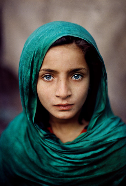 Peshawar, Pakistan, 2002. An Afghan refugee girl in a green headscarf. (Photo by  Steve McCurry/Taschen/Magnum Photos/The Guardian)