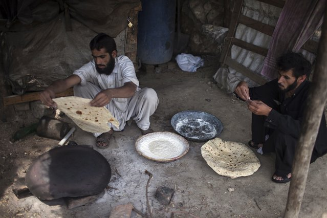 A miner cooks Pashtun roti (bread) after finishing his shift at a coal mine in Choa Saidan Shah, Punjab province, May 5, 2014. (Photo by Sara Farid/Reuters)