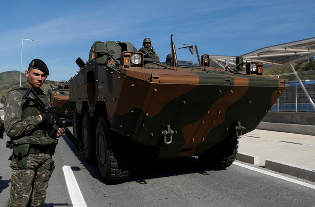 Brazilian Army armored vehicles attend a street patrolling exercise on the Transolimpica expressway that will connect the Recreio dos Bandeirantes and the Deodoro neighborhoods in the West Zone, linking the two main venues of the 2016 Rio Olympics in Rio de Janeiro, Brazil, July 9, 2016. (Photo by Bruno Kelly/Reuters)