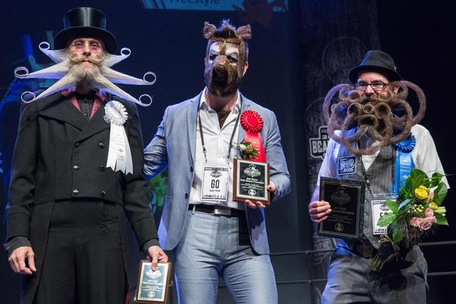 (L- R): Third, second and first place winners of the full beard freestyle Aarne Bielefeldt, Isaiah Webb, and Jason Kiley at the 2017 Remington Beard Boss World Beard & Moustache Championships held at the Long Center for the Performing Arts on September 3, 2017 in Austin, Texas. (Photo by Suzanne Cordeiro/AFP Photo)