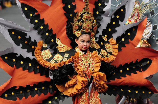 A model wears a Borobudur costume in the kids carnival during The 13th Jember Fashion Carnival 2014 on August 21, 2014 in Jember, Indonesia. (Photo by Robertus Pudyanto/Getty Images)