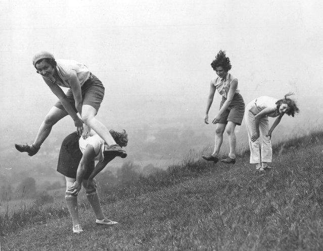 Girls playing a game of leap-frog, circa 1938.
