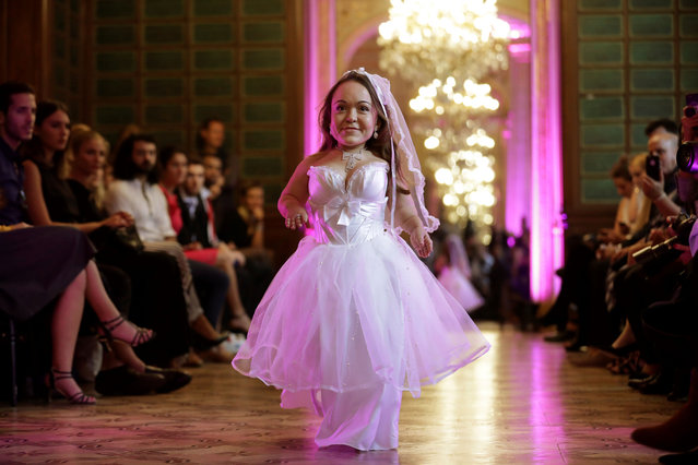 A model presents a creation during the International Dwarf Fashion Show, on September 26, 2017 in Paris, France. (Photo by Thomas Samson/AFP Photo)