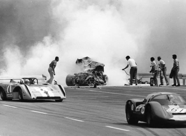 Mexican racing driver Ricardo Rodriguez sitting in his burning Ferrari was overtaken by other cars today, July 11, 1971,during the race for the European Interseries Cup, which took place at Nuernberg's Noris-Ring racing circuit, Germany. Rodriguez, who collided with a guardrail, died on the way to hospital. (Photo by AP Photo)