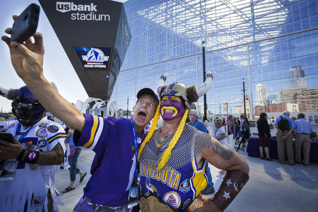 Minnesota Vikings fans Larry Spooner, left, of Plymouth, and Syd Davy, of Vancouver, British Columbia, pose for a photo at the ceremonial grand opening ribbon-cutting for U.S. Bank Stadium in Minneapolis, Friday, July 22, 2016. (Photo by Leila Navidi/Star Tribune via AP Photo)