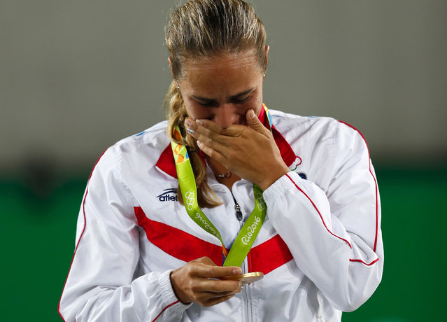 Monica Puig of Puerto Rico cries after winning the gold medal of the women's tennis competition at the 2016 Summer Olympics in Rio de Janeiro, Brazil, Saturday, August 13, 2016. (Photo by Vadim Ghirda/AP Photo)