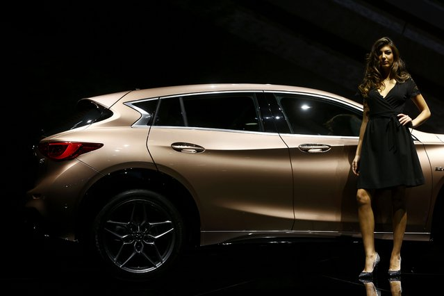 A model poses with an Infiniti Q30 during the media day at the Frankfurt Motor Show (IAA) in Frankfurt, Germany, September 15, 2015. (Photo by Kai Pfaffenbach/Reuters)