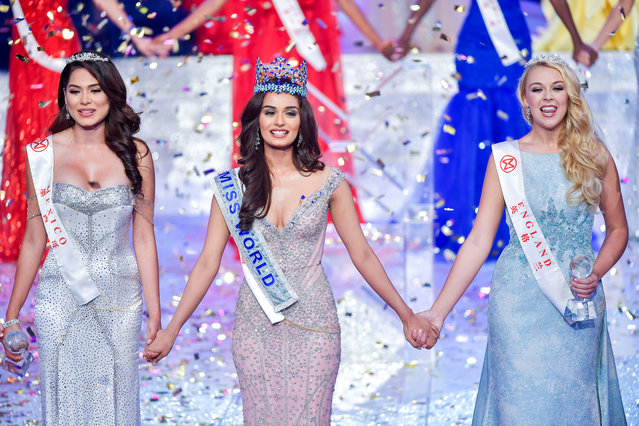 Winner of Miss World Miss India Manushi Chhillar holds hands with first runner-up Miss Mexico Andrea Meza and second runner-up Miss England Stephanie Hill at the Miss World pageant in Sanya, Hainan province, China November 18, 2017. (Photo by Luo Yunfei/Reuters/CNS)