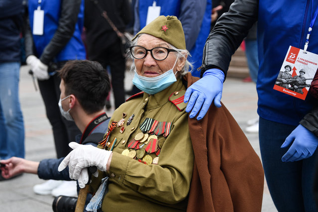WWII veteran Antonina Farvazova attends a Victory Day military parade marking the 75th anniversary of the victory in World War II in Vladivostok, Russia on June 24, 2020. Victory Day parades across Russia have been postponed from 9 May to 24 June due to restrictions imposed to prevent the spread of the novel coronavirus. (Photo by Yuri Smityuk/TASS via Getty images)