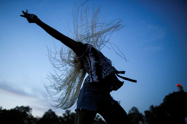 A woman dances as she takes part in the Annual Afropunk Music festival in the borough of Brooklyn in New York, U.S., August 27, 2016. (Photo by Eduardo Munoz/Reuters)