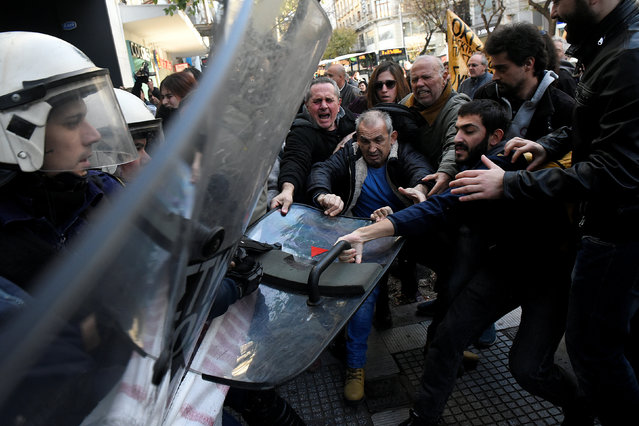 Demonstrators scuffle with riot police officers during a protest against home auctions in Thessaloniki, Greece, November 29, 2017. (Photo by Alexandros Avramidis/Reuters)