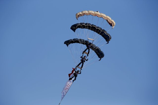 British Army parachutists from The Tigers, the Princess of Wales's Royal Regiment's Parachute display team, take part in a display during the Malta International Airshow at Malta International Airport, outside Valletta, Malta, September 27, 2015. (Photo by Darrin Zammit Lupi/Reuters)