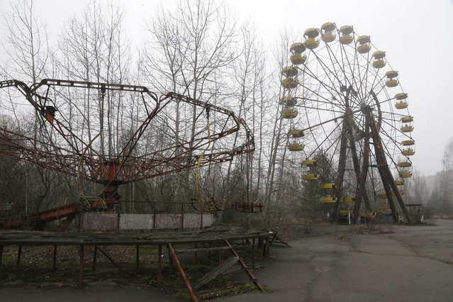 A playground in the deserted town of Pripyat, Ukraine, some 3 kilometers (1.86 miles) from the Chernobyl nuclear plant  Ukraine, November 27, 2012. (Photo by Efrem Lukatsky/AP Photo)
