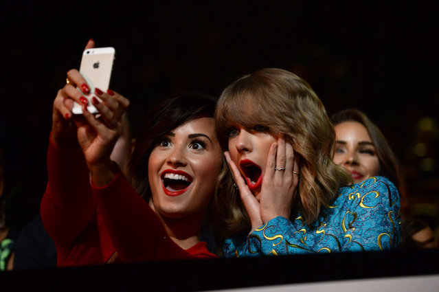 Recording artists Demi Lovato (L) and Taylor Swift take a selfie at the 2014 MTV Video Music Awards at The Forum on August 24, 2014 in Inglewood, California.  (Photo by Jeff Kravitz/MTV1415/FilmMagic)